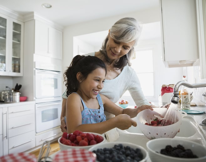 Grandma and child washing fruit