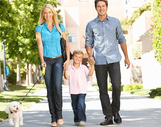family-walking-dog-min
